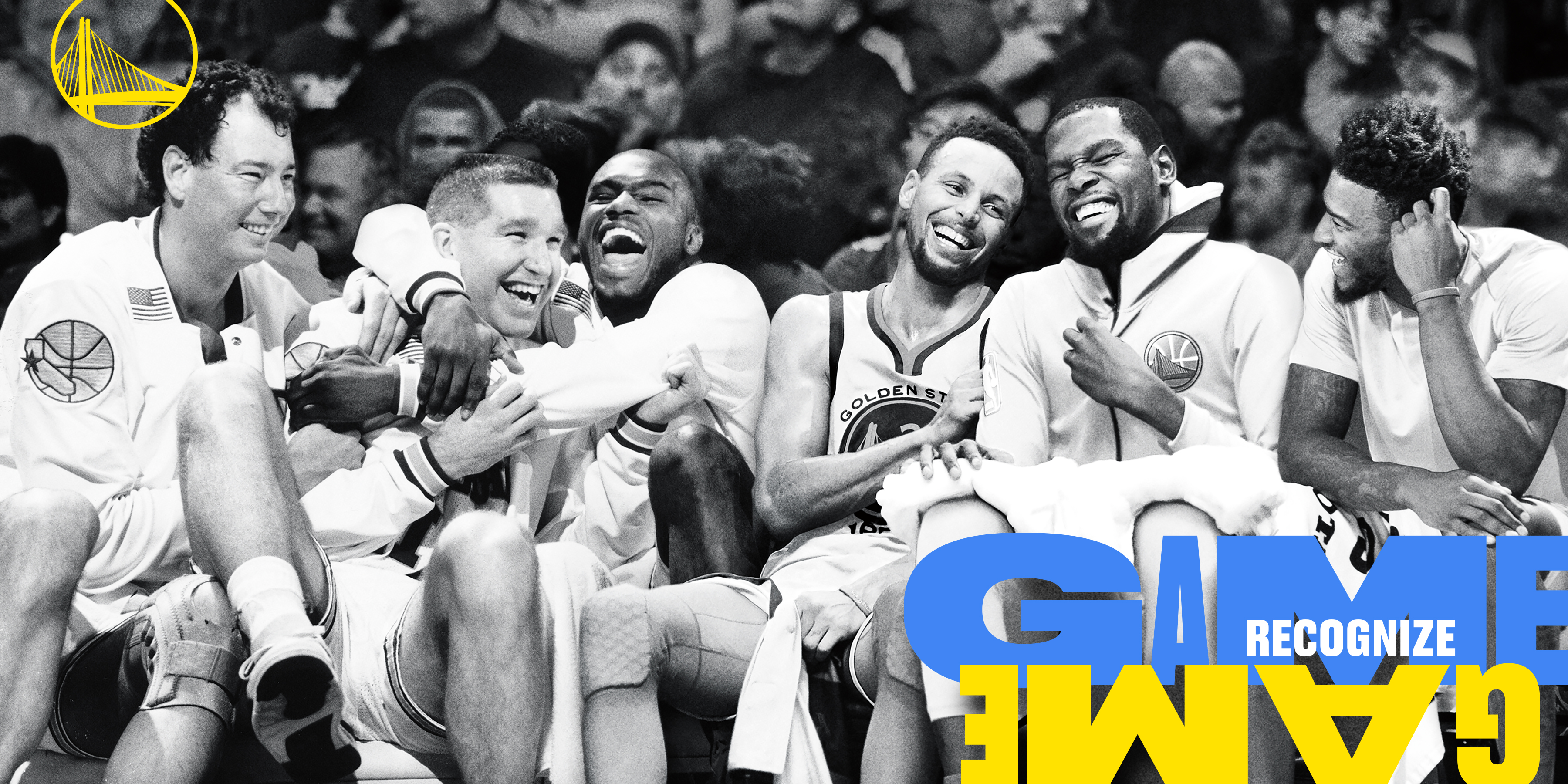 "Black and white photo of a group of Golden State Warriors basketball players sitting on the sidelines. They are laughing and poking good fun at each other. The team's logo is in the top left corner in golden yellow and on the bottom right corner is text that reads ""game recognize game"" but the second ""game"" is upside down."