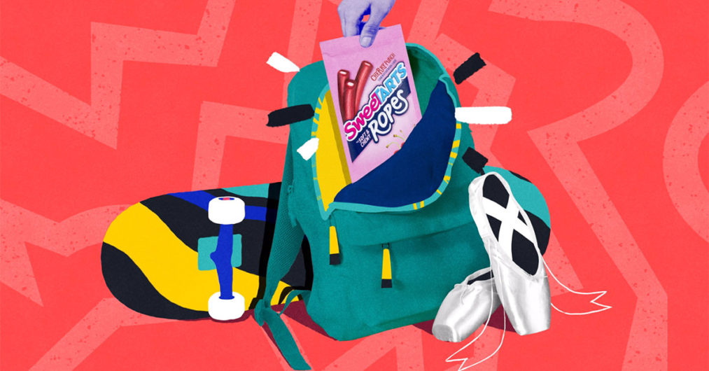 An energetic graphic design centers a bag of SweeTARTS candy. The background of the design is red with a lighter red lightning bolt. In the center of the image is a skateboard, ballet slippers, and a bookbag. The book bag is open and the SweeTARTS candy sits in the bag.