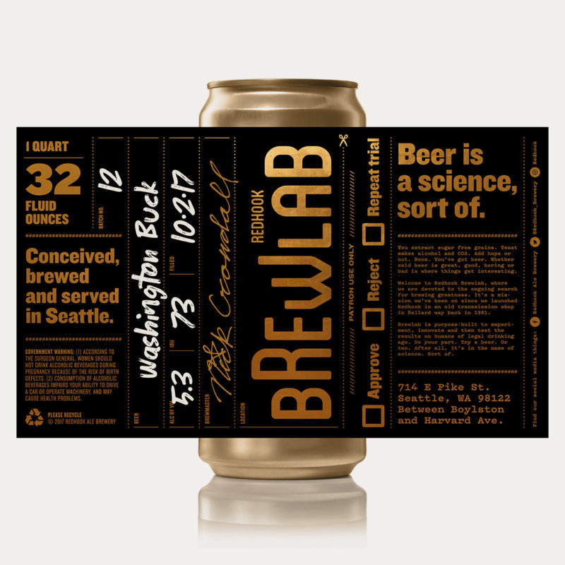 A gold beer can with the black and gold designed Brewlab label on a white background. The label is fully rolled out as an image so you can see all the design elements and text that appears on the label. The label is black and the text is gold and white.